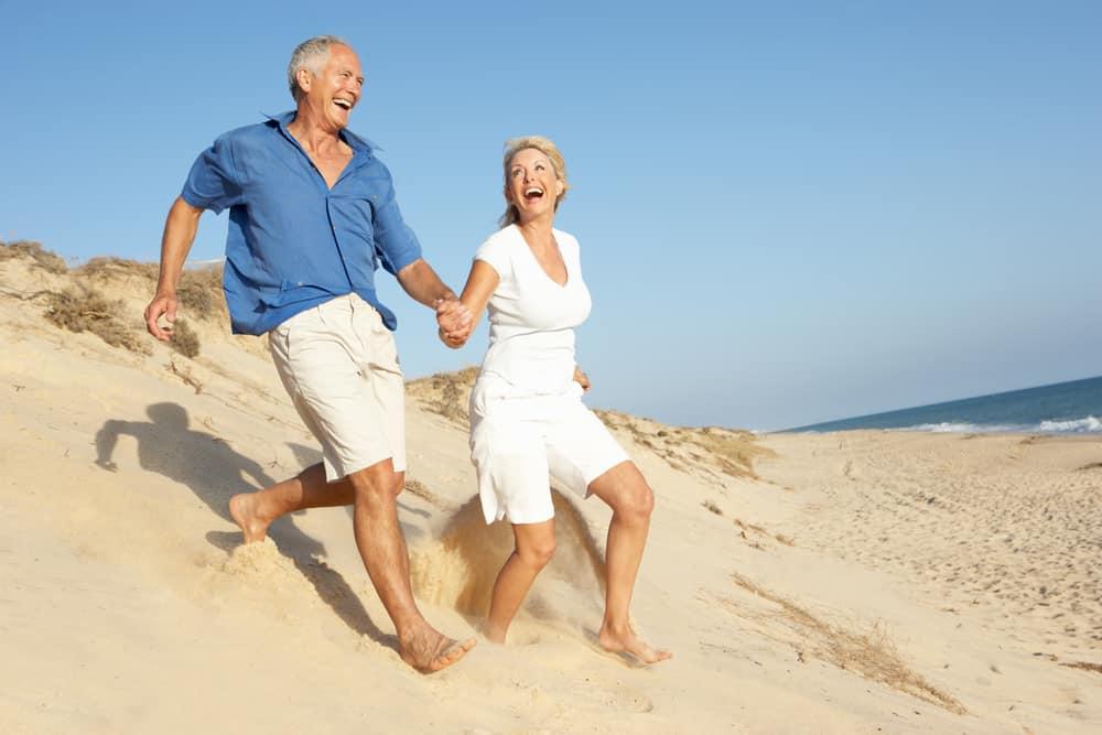 couple running on beach orthobiologics treatments